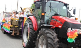 Tractor pulling a parade float at Truro Pride