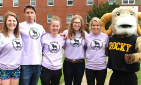 Five student orientation volunteers with Rocky the Ram