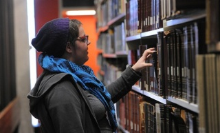 A student looks at books in the library