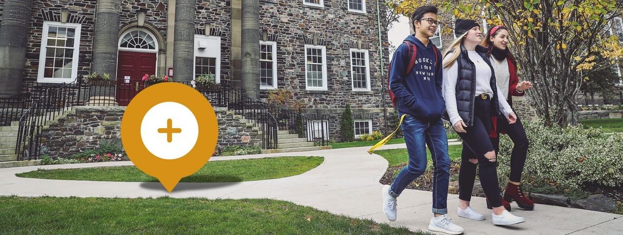 Three students walking on the Halifax campus