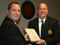 Gil Hughes receiving award from Police Chief