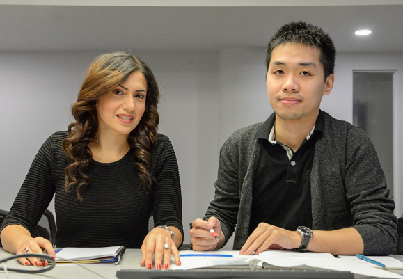 Data analyst Sara Sabri and Dalhousie pharmacy student Isaac Bai
