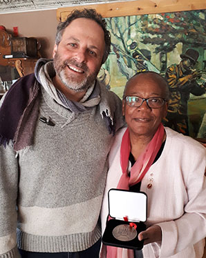 Jeff Karbanow (left) receives his Senate 150th Anniversary Medal from Senator Wanda Thomas Bernard. (Provided photo)
