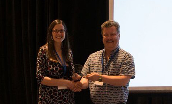 Kim Davies accepting her award from CNC-SCOR chair, Paul Myers.