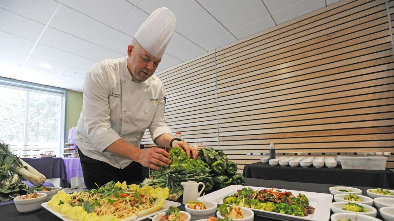 Chef Mike Silvester, preparing a catering display.