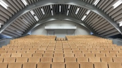 Image of large, open lecture theatre. Link leads to FOCUS blog post titled, Considering Integrity in Assessments for Large Classes
