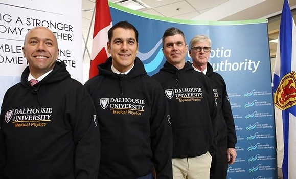 Left to right: Andy Fillmore, Stefan Vilsmeier, James Robar and Drew Bethune standing in front of a Nova Scotia Health Authority backdrop at the Brainlab AG announcement