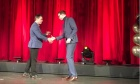 """Andrew Holland recent MHA graduate recieved the 2019 Impact Award for his help in the adoption of """"BikeAround"""""""