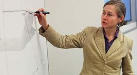 Professor using white board