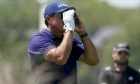 How far away are professional golfers from accepting rangefinders in competition?