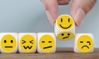 What does it mean to be happy during troubled times? Upcoming symposium explores some possible answers
