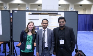 Siobhan, Dr. Habib, and Nazmul present a poster