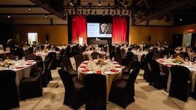 A room with tables set for the 2018 gala.